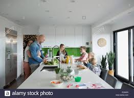 family eating around kitchen island stock photo royalty free