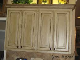 Antiqued White Kitchen Cabinets by How To Antique Paint Kitchen Cabinets Get Inspired With Home
