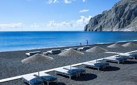 beaches with black sand hotel beach in kamari santorini bellonias villas