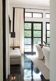 White Curtains With Blue Trim Decorating Black Lantern Wall Sconces Window Upholstered Seating Ivory