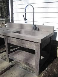 reclaimed wood vanity base and concrete bathroom sink by trueform