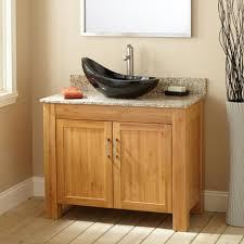 bathroom brown wooden vanity granite countertop glass faucet
