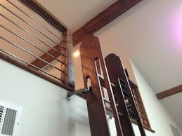 Rolling Bookcase Ladder by Our Pivoting Loft Ladder Adds An Extra Layer Of Safety By Holding