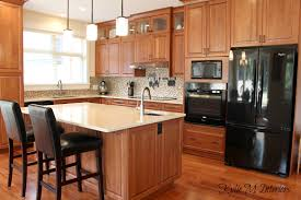 pictures of kitchens with black appliances cherry kitchen cabinets in modern transitional kitchen with crema