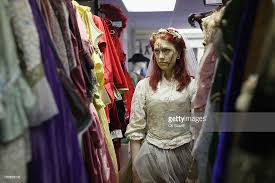 staff at angels fancy dress shop prepare costumes for the