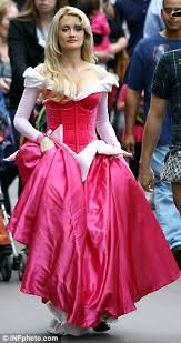 pregnant holly madison squeezes baby bump sleeping beauty