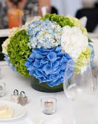 white and blue floral arrangements charleston wedding by captured by kate photography blue