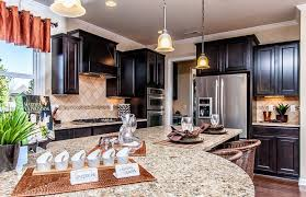 versus light kitchen cabinets giallo ornamental granite for warm kitchen design