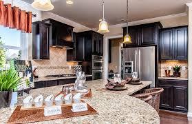 kitchen cabinets with light granite countertops giallo ornamental granite for warm kitchen design