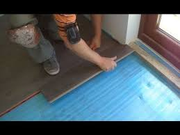 how to lay laminate wood flooring to the patio door
