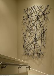 new ways to use art in a room room walls and metal tree