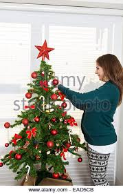 pregnant woman decorating christmas tree stock photo royalty free
