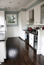 gray kitchen with white cabinets blue gray kitchen with black counter tops and white cabinets