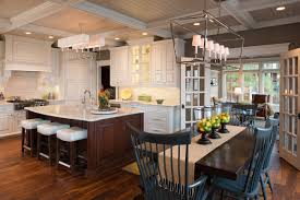 pictures of white kitchen cabinets with island traditional white kitchen with cherry island