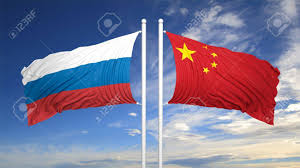 Image Chinese Flag Russian And Chinese Flags Against Of Blue Sky Lizenzfreie Fotos