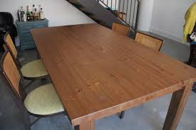 how to make a dining table from an old door how to make an ikea table look old distressing techniques a