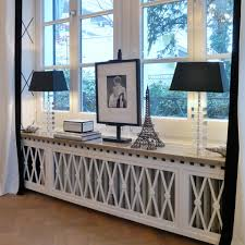 this is a stunning way to disguise a radiator and showcase your