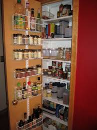 high vertical narrow kitchen pantry cabinet on red wall color