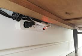 Electrical Outlet Strips Under The Cabinet How To Hide Tv Wires For A Cord Free Wall Young House Love