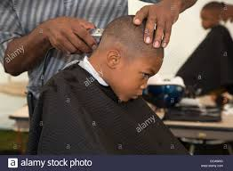 detroit michigan usa a boy gets a haircut at a back to