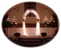 wedding arches decorated with tulle lanterns and candles to pews for weddings how can i