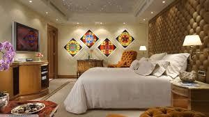 luxury hotel bedroom designs white table lamp on bedside dark