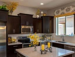 Above Kitchen Cabinets Ideas Greenery Above Kitchen Cabinets Ideas With Artificial Flowers And