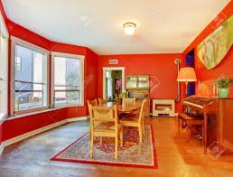 Red Dining Room by Red Dining Room With Piano Hardwood Floor And Many Windows Stock