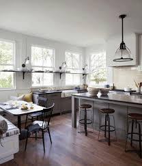 white kitchen wood island checkered floors dark brown wooden island fancy brass utensils