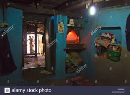 rural indian home interior with hindu shrine in corner of room in