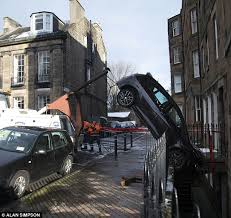 car in edinburgh on its nose after crashing down into basement
