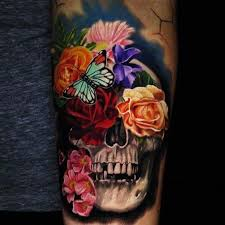skull in colored flowers on left arm
