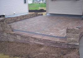 Slabbed Patio Designs How To Build A Raised Patio With Retaining Wall Blocks