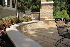 large tile patio pavers with seating retaining wall and limestone