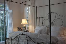 traditional black wrought iron bed frames mixed green pillows and