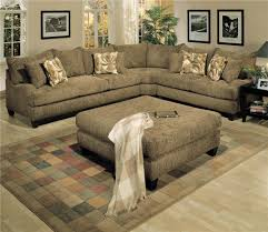 black leather sofa with grey brown cushions with round glasses of