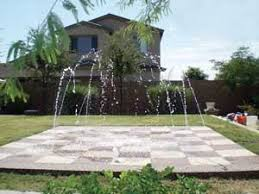 Backyard Staycations Interactive Wet Decks Are Kid Friendly And Make An Economical