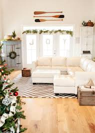 add cheer to your windows by decorating them for christmas green garland for window decoration