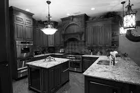 gothic two toned cabinets in kitchen with dark grey wood and white