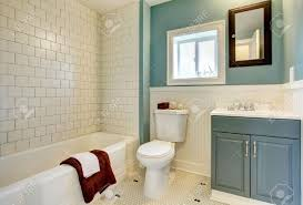 classic simple blue bathroom with white tile stock photo picture