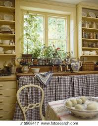 Cottage Kitchen Curtains by Picture Of Blue Checked Curtains On Cupboards Below Window In