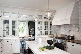 walnut driftwood glass panel door light fixtures over kitchen