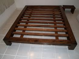 bathroom queen size varnished hardwood plank bed frame with tall