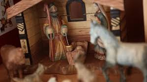 a beautiful hand carved nativity set on the shelf of a home for
