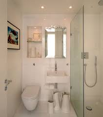 Luxury White Bathroom Design With Tankless White Wall Hung Toilets - English bathroom design