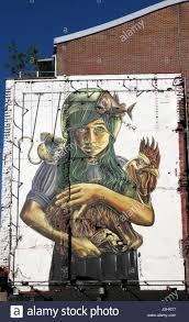 italian artist vera bugatti mural teratology of girl holding italian artist vera bugatti mural teratology of girl holding strange cockerel mouse fish on wall in clerkenwell london uk kathy dewitt