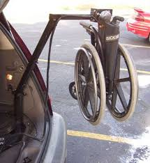 wheelchair lifting system for a pt cruiser
