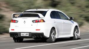 mitsubishi sports car 2014 mitsubishi lancer evolution updated for 2014 photos 1 of 8