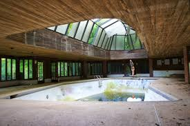 abandoned bankrupt tennis players mansion with indoor pool