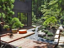 japanese garden style with wooden deck and foot step with zen